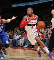 WASHINGTON, DC - JANUARY 20: Bradley Beal #3 of the Washington Wizards drives against Evan Turner #12 of the Philadelphia 76ers during the game at the Verizon Center on January 20, 2014 in Washington, DC. (Photo by Ned Dishman/NBAE via Getty Images)
