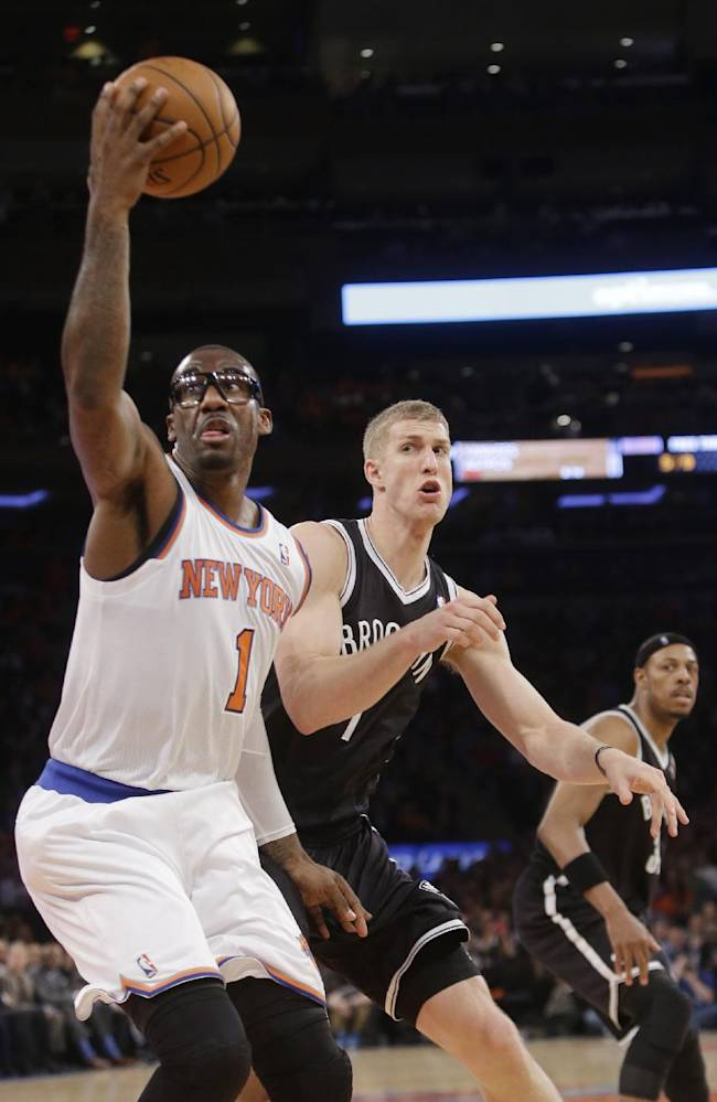 New York Knicks' Amar'e Stoudemire (1) catches the ball in front of Brooklyn Nets' Mason Plumlee (1) during the first half of an NBA basketball game Wednesday, April 2, 2014, in New York