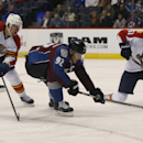 Colorado Avalanche left wing Gabriel Landeskog, center, of Sweden, loses control of the puck while rushing the net as Florida Panthers left wing Jussi Jokinen, left, of Finland, and defenseman Brian Campbell cover in the first period of an NHL hockey gam