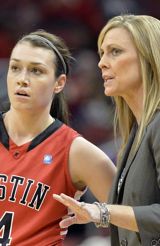 Austin Peay head coach Carrie Daniels talks with Kristen Stainback during the first half of an NCAA college basketball game against Louisville Saturday Dec. 14, 2013, in Louisville, Ky