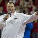 Arkansas head football coach Bret Bielema speaks during a time out in the first half an NCAA college basketball game against Tennessee in Fayetteville, Ark., Saturday, Feb. 2, 2013. Arkansas defeated Tennessee 73-60. (AP Photo/Gareth Patterson)