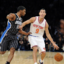 New York Knicks' Pablo Prigioni, right, of Argentina, reacts as he is guarded by Orlando guard Ronnie Price during the second quarter of an NBA basketball game Friday, Dec. 6, 2013, at Madison Square Garden in New York. The Knicks won 121-83 The Associate