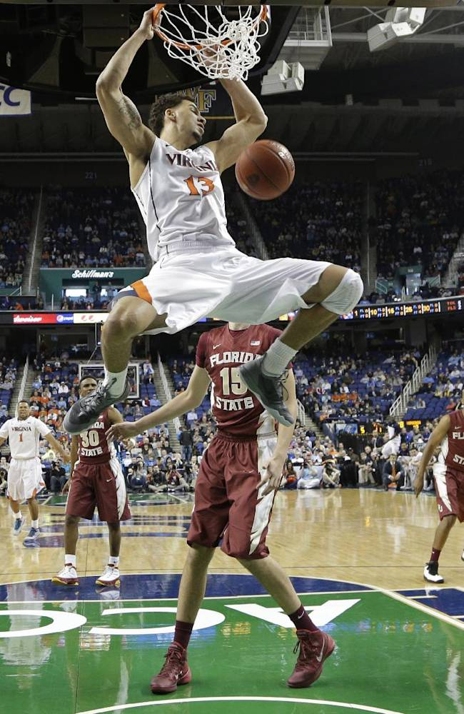 Virginia's Anthony Gill (13) dunks against Florida State during the first half of a quarterfinal NCAA college basketball game at the Atlantic Coast Conference tournament in Greensboro, N.C., Friday, March 14, 2014