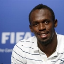 Jamaican sprinter Usain Bolt poses after a news conference during his visit to the FIFA headquarters in Zurich August 28, 2013. REUTERS/Arnd Wiegmann