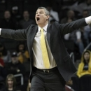 La Salle head coach John Giannini yells at his team during the second half of an NCAA college basketball game against Butler at the Atlantic 10 Conference tournament, Friday, March 15, 2013, in New York. Butler won 69-58. (AP Photo/Mary Altaffer)