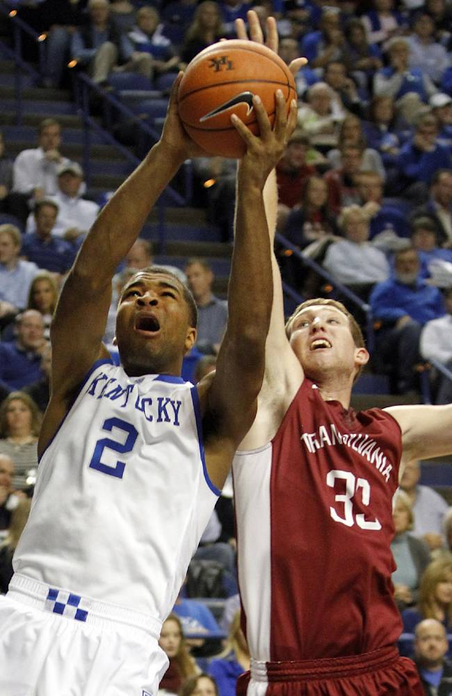 Kentucky's Aaron Harrison (2) shoots under pressure from Transylvania's Chris Taylor (33) during the first half of an NCAA basketball exhibition game, Friday, Nov. 1, 2013, in Lexington, Ky