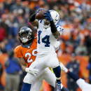 Indianapolis Colts wide receiver Hakeem Nicks, right, makes a catch as Denver Broncos cornerback Bradley Roby, rear, defends during the first half of an NFL divisional playoff football game, Sunday, Jan. 11, 2015, in Denver The Associated Press
