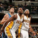 INDIANAPOLIS, IN - OCT 10: Lavoy Allen #5 and Chris Copeland #22 of the Indiana Pacers battle for position against Nikola Vucevic #9 of the Orlando Magicat Bankers Life Fieldhouse on October 10, 2014 in Indianapolis, Indiana. (Photo by Ron Hoskins/NBAE via Getty Images)