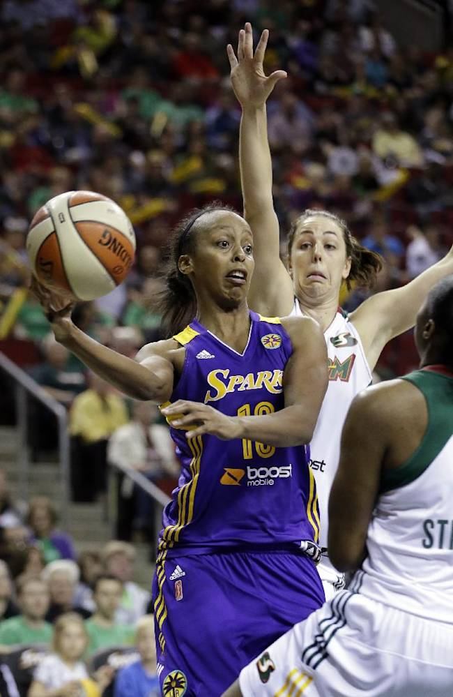 Los Angeles Sparks' Lindsey Harding, left, tries to pass between Seattle Storm's Shekinna Stricklen and Jenna O'Hea in the second half of a WNBA basketball game Friday, May 16, 2014, in Seattle. The Sparks won 80-69