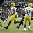 Green Bay Packers wide receiver Randall Cobb, right, comes down with a reception for a touchdown against the Seattle Seahawks in the second half of an NFL football game, Thursday, Sept. 4, 2014, in Seattle The Associated Press