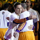 Los Angeles Lakers' Steve Nash, left, hugs teammate Steve Blake after Nash was introduced in the starting line-up for an NBA basketball game against the Utah Jazz in Los Angeles, Tuesday, Feb. 11, 2014 The Associated Press