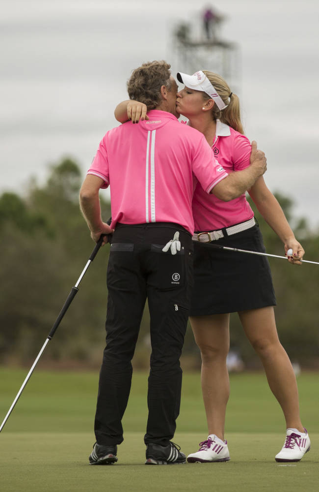 Bernhard Langer gives his daughter Christina Langer a hug on the 18th hole during the Father-Son Challenge at the Ritz-Carlton Golf Club in Orlando, Fla., Sunday, Dec. 15, 2013