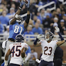 Detroit Lions wide receiver Calvin Johnson (81), defended by Chicago Bears cornerback Kyle Fuller (23), catches a 25-yard reception for a touchdown during the first half of an NFL football game in Detroit, Thursday, Nov. 27, 2014 The Associated Press