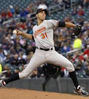 Baltimore Orioles starting pitcher Ubaldo Jimenez delivers to the Minnesota Twins during the first inning of a baseball game, Friday, May 2, 2014, in Minneapolis. (AP Photo/Ann Heisenfelt)