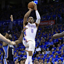 Oklahoma City Thunder guard Russell Westbrook (0) shoots between Memphis Grizzlies guard Mike Conley (11) and Memphis Grizzlies forward Zach Randolph (50) during the fourth quarter of Game 1 of the opening-round NBA basketball playoff series in Oklahoma C
