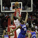 Houston Rockets' Dwight Howard (12) dunks against Philadelphia 76ers' Thaddeus Young (21) as 76ers' Hollis Thompson (31) looks on during the first half of an NBA basketball game on Thursday, March 27, 2014, in Houston The Associated Press
