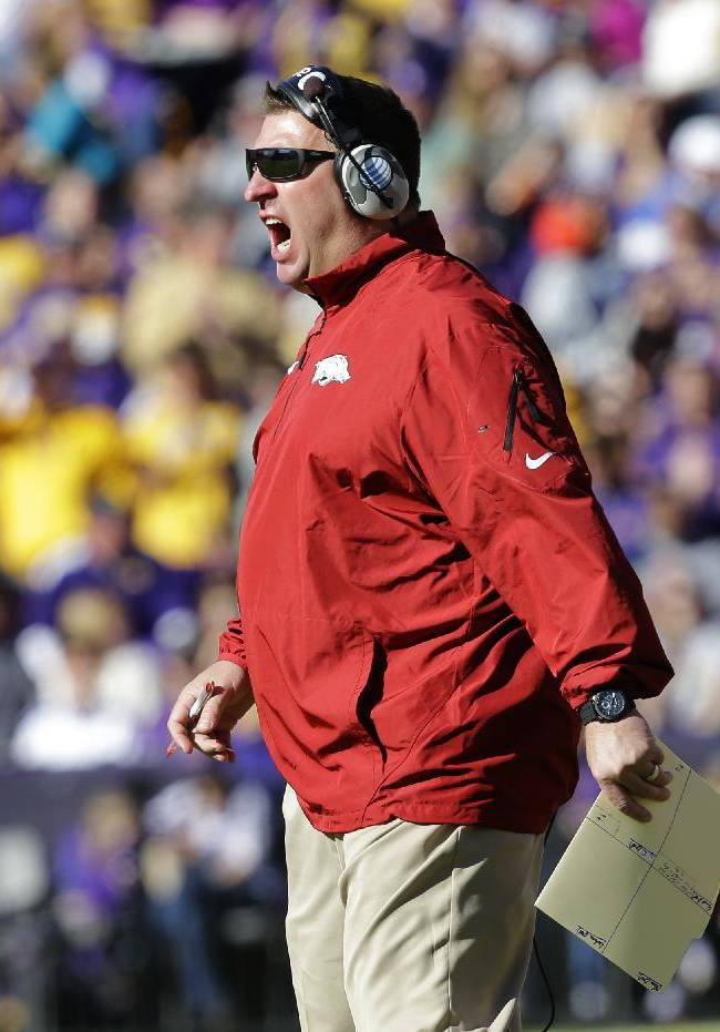Arkansas head coach Bret Bielema shouts to the officials after a touchdown run was called back in the first half of an NCAA college football game against LSU in Baton Rouge, La., Friday, Nov. 29, 2013
