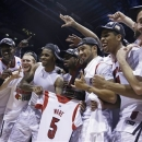 Louisville players celebrate following their 85-63 win over Duke in the Midwest Regional final in the NCAA college basketball tournament, Sunday, March 31, 2013, in Indianapolis. (AP Photo/Michael Conroy)