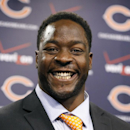 Chicago Bears defensive end Lamarr Houston smiles after being introduced as the newest member of the team during a news conference Wednesday, March 12, 2014, in Lake Forest, ill The Associated Press