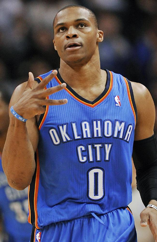 In this Dec. 21, 2013, file photo,, Oklahoma City Thunder guard Russell Westbrook celebrates a 3-point basket during the first half of an NBA basketball game against the San Antonio Spurs in San Antonio.  Yes, the Thunder are rolling without him, but Westbrook, when healthy, is one of the most dynamic players in the NBA. He has been out since late December after having surgery on his right knee