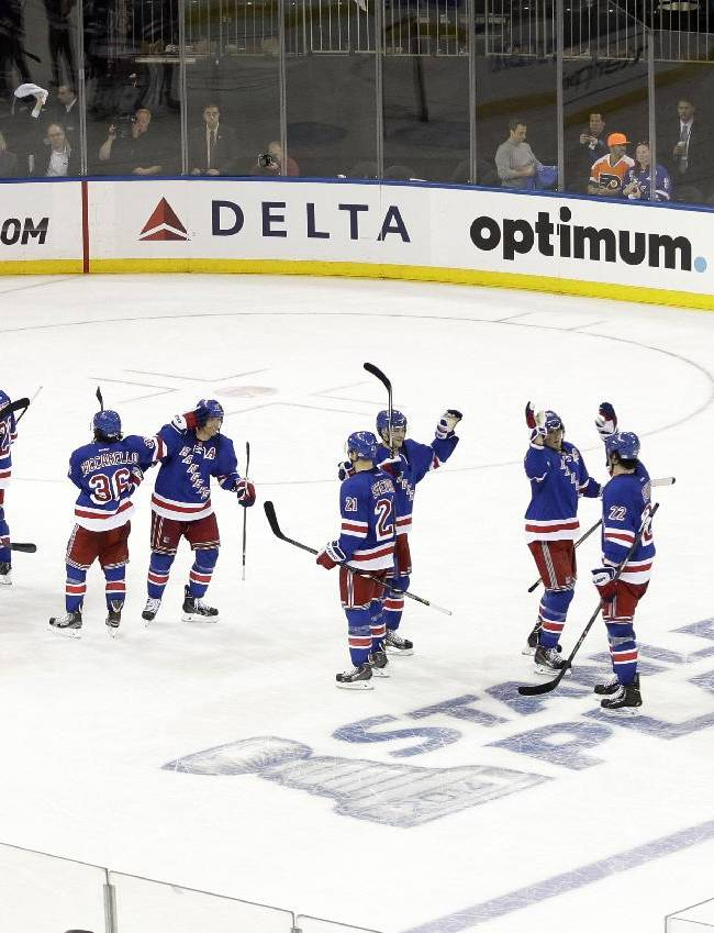 The New York Rangers celebrate after Game 1 of an NHL hockey first-round playoff series against the Philadelphia Flyers, Thursday, April 17, 2014, in New York. The Rangers won the game 4-1