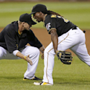 In this July 31, 2013, file photo, Pittsburgh Pirates center fielder Andrew McCutchen , right, celebrates with A.J. Burnett after the Pirates' 5-4 win over the St. Louis Cardinals in a baseball game in Pittsburgh. McCutchen might be the best player on th