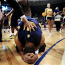 North Carolina A&T's DaMetrius Upchurch, bottom, celebrates after defeating Morgan State 57-54 in an NCAA college basketball game in the championship of the Mid-Eastern Athletic Conference tournament, Saturday, March 16, 2013, in Nofolk, Va. (AP Photo/The Virginian-Pilot, Steve Earley)