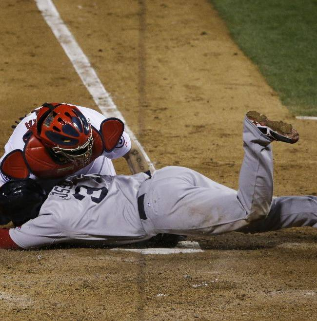 Boston Red Sox David Ross is tagged out by St. Louis Cardinals catcher Yadier Molina as he tries to score from second on a single by Jacoby Ellsbury during the seventh inning of Game 5 of baseball's World Series Monday, Oct. 28, 2013, in St. Louis