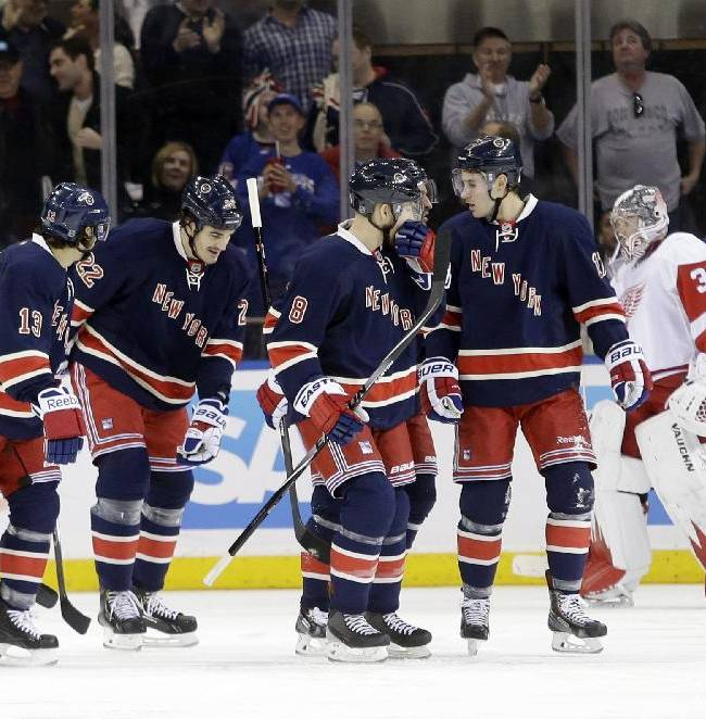 New York Rangers center Brian Boyle (22) celebrates a goal with teammates as Detroit Red Wings goalie Jimmy Howard (35) reacts during the first period of an NHL hockey game on Sunday, March 9, 2014, in New York. The Rangers won the game 3-0