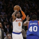 Philadelphia 76ers' Jarvis Varnado (40) runs out to defend a shot by New York Knicks' J.R. Smith (8) as Mike Woodson, left, watches, during the first half of an NBA basketball game Monday, March 10, 2014, in New York The Associated Press