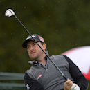 Graeme McDowell, of Northern Ireland, tees off on the first hole during the third round of the Northwestern Mutual World Challenge golf tournament at Sherwood Country Club, Saturday, Dec. 7, 2013, in Thousand Oaks, Calif. (AP Photo/Mark J. Terrill)