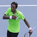 Gael Monfils, of France, reacts after defeating Grigor Dimitrov, of Bulgaria, during the fourth round of the 2014 U.S. Open tennis tournament, Tuesday, Sept. 2, 2014, in New York. (AP Photo/Darron Cummings)