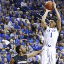 Kentucky's Devin Booker (1) shoots near Providence's Jalen Lindsey (21) during the first half of an NCAA college basketball game, Sunday, Nov. 30, 2014, in Lexington, Ky. (AP Photo/James Crisp)
