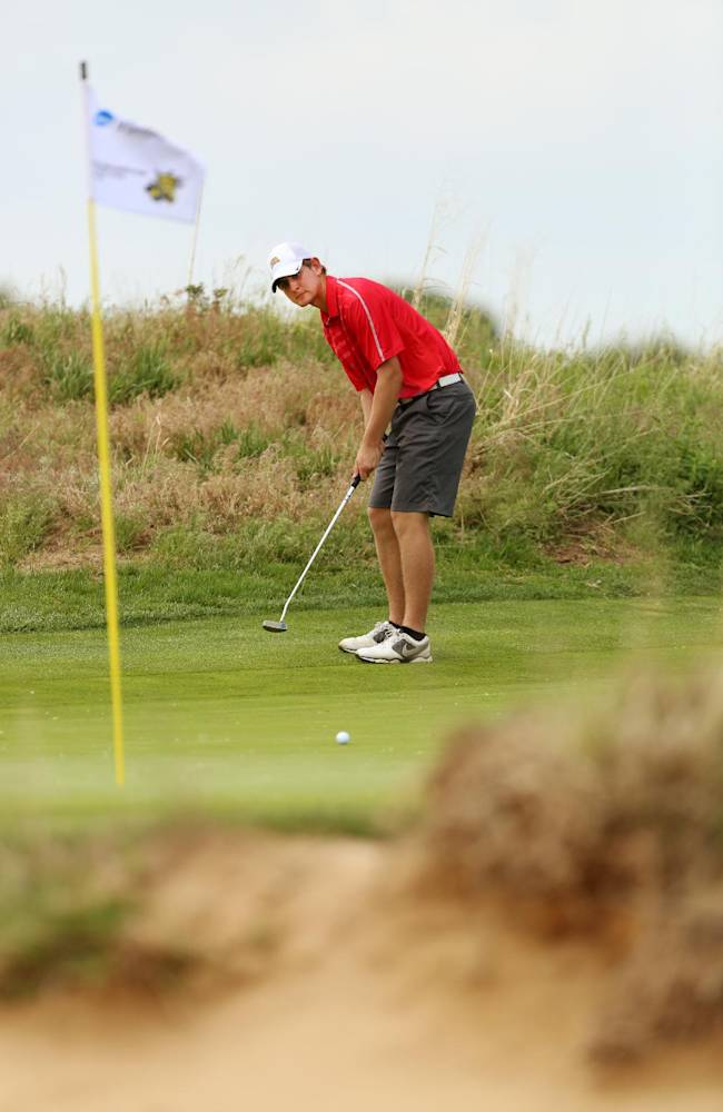 Iowa State's Jack Carter putts on the seventh green during the second round of the NCAA national championship Sunday, May 25, 2014 at Prairie Dunes Country Club in Hutchinson, Kan