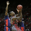 Utah guard Delon Wright (55) goes to the basket as Arizona's Stanley Johnson, left, Rondae Hollis-Jefferson, right, defend in the second half of an NCAA college basketball game Saturday, Feb. 28, 2015, in Salt Lake City. (AP Photo/Rick Bowmer)