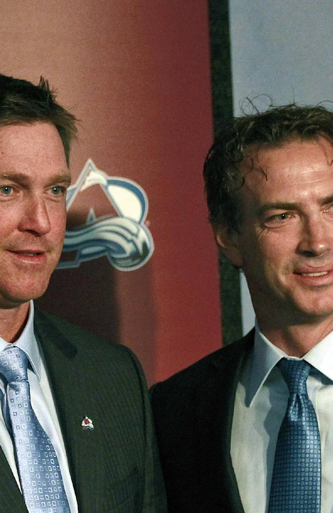 In this May 28, 2013 file photo, Colorado Avalanche coach Patrick Roy, left, and Joe Sakic, pose together at a news conference in Denver. After another disappointing season, the Avalanche shook up the team, bringing in Roy, and giving Sakic, the longtime face of the franchise, more responsibility in the front office. Matt Duchene, Gabriel Landeskog and the rest of the Avs kick off training camp on Thursday, Sept. 12, 2013