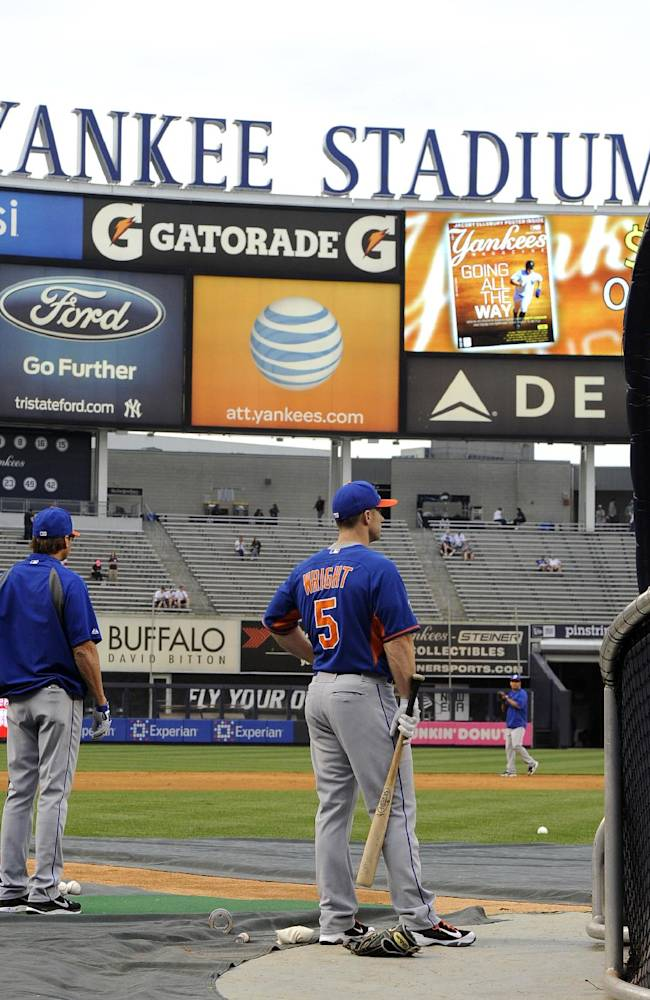 New York Mets' David Wright (5) awaits his turn at batting practice next to third base coach Tim Teufel before the inter league baseball game against the New York Yankees at Yankee Stadium on Monday, May 12, 2014, in New York