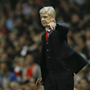 Arsenal's manager Arsene Wenger points to his players during a second leg Champions League qualifying soccer match between Arsenal and Besiktas at Emirates Stadium in London Wednesday, Aug. 27, 2014