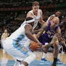 Los Angeles Lakers center Robert Sacre, right, struggles to recover a loose ball as, from front left to back, Denver Nuggets guard Ty Lawson, center Timofey Mozgov, of Russia, and forward Kenneth Faried cover in the first quarter of an NBA basketball game