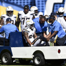 San Diego Chargers running back Ryan Mathews is carted off the field after being injured during the second half of an NFL football game against the Seattle Seahawks, Sunday, Sept. 14, 2014, in San Diego. (AP Photo/Denis Poroy)