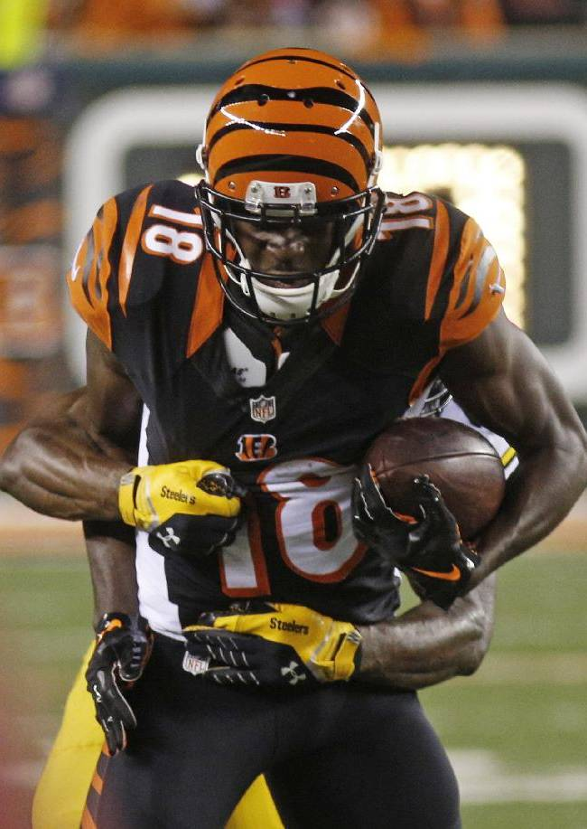 Cincinnati Bengals wide receiver A.J. Green (18) is tackled after catching a pass against the Pittsburgh Steelers in the second half of an NFL football game, Monday, Sept. 16, 2013, in Cincinnati. Cincinnati won20-10