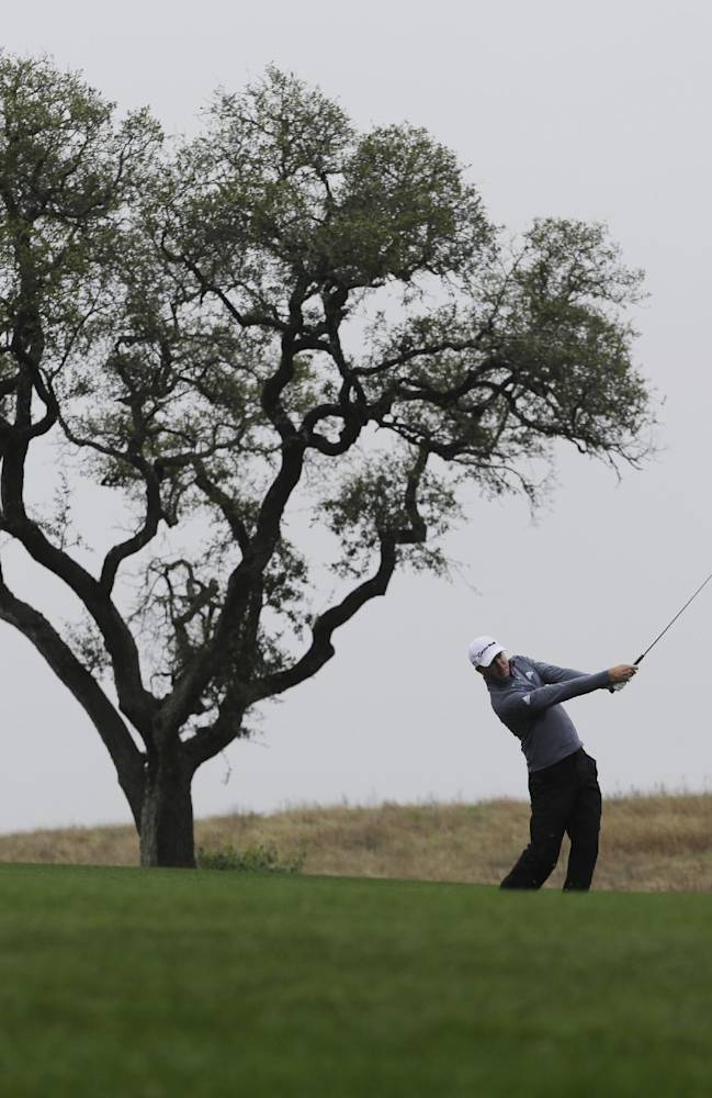 Defending champion Martin Laird, of Scotland, hits from the fairway on the 10th hole during the first round of the Valero Texas Open golf tournament, Thursday, March 27, 2014, in San Antonio