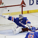 New York Rangers goalie Henrik Lundqvist (30), of Sweden, defends the goal during the third period of an NHL hockey game against the Tampa Bay Lightning Monday, Nov. 17, 2014, in New York. The Lightning won the game 5-1 The Associated Press
