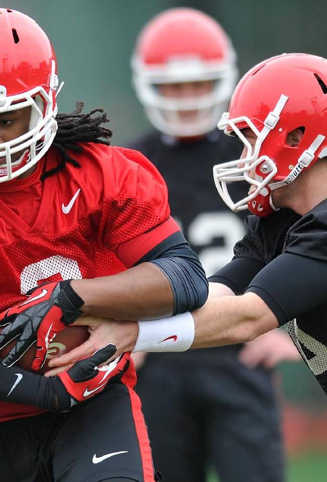 Georgia running back Todd Gurley (3), left, takes a handoff from Georgia quarterback Hutson Mason (14) during a Georgia spring football practice on Tuesday, March 18, 2014, in Athens, Ga