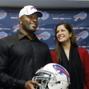 FILE - In this March 15, 2012 photo, Buffalo Bills' Mario Williams poses for a photo with his fiancee Erin Marzouki smile after an NFL football news conference in Orchard Park, N.Y. Here's one thing that can happen when love goes bad: Bills defensive end Mario Williams is suing his ex-fiancee, demanding she return a $785,000 diamond engagement ring. In response, Marzouki has filed a countersuit, calling Williams' demands