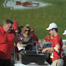In this July 27, 2014, file photo, Kansas City Chiefs season-ticket holders line up for pancakes before the NFL football team's training camp in St. Joseph. Mo. By making fans feel as though they're part of the team, and offering gifts and experiences exc