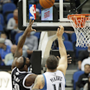 Brooklyn Nets' Reggie Evans, left, shoots as Minnesota Timberwolves' Nikola Pekovic, of Montenegro, defends in the first quarter of an NBA basketball game Friday, Nov. 22, 2013, in Minneapolis The Associated Press