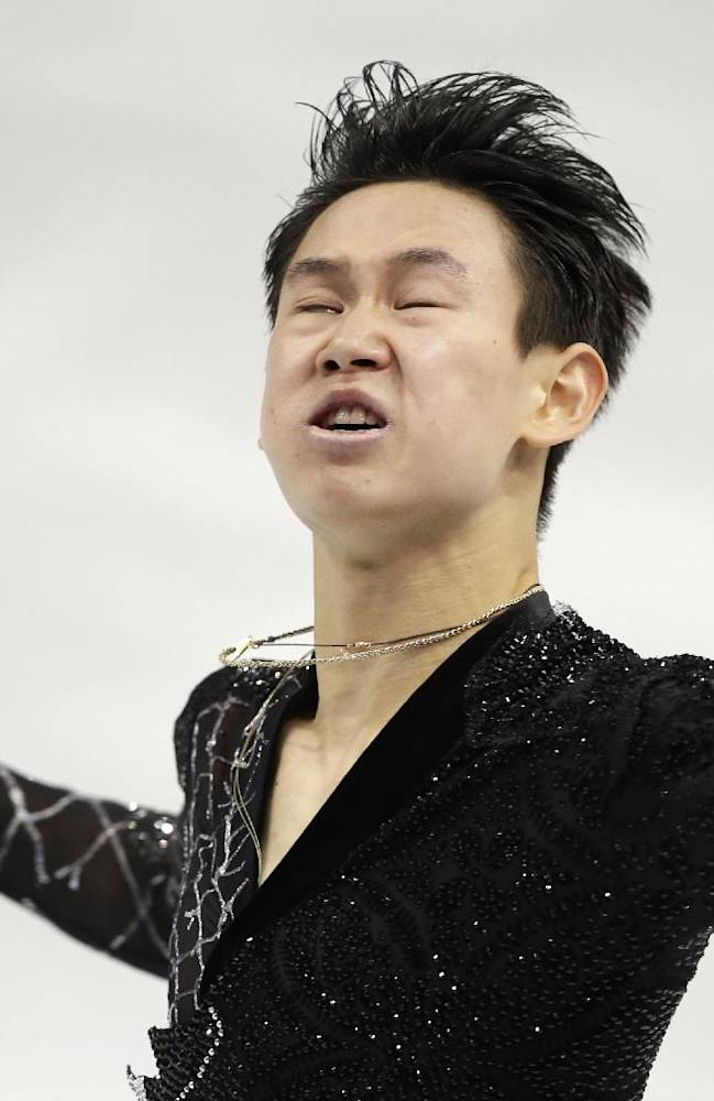 Denis Ten of Kazakhstan competes in the men's short program figure skating competition at the Iceberg Skating Palace during the 2014 Winter Olympics, Thursday, Feb. 13, 2014, in Sochi, Russia