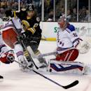 New York Rangers goalie Henrik Lundqvist (30) makes a pad save as Boston Bruins left wing Milan Lucic (17) looks to get a shot on goal during the second period of an NHL hockey game, Saturday, March 28, 2015, in Boston. (AP Photo/Mary Schwalm)