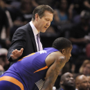 Phoenix Suns head coach Jeff Hornacek, rear, talks to Suns' Eric Bledsoe during the first half of an NBA basketball game against the San Antonio Spurs on Friday, April 11, 2014, in San Antonio The Associated Press